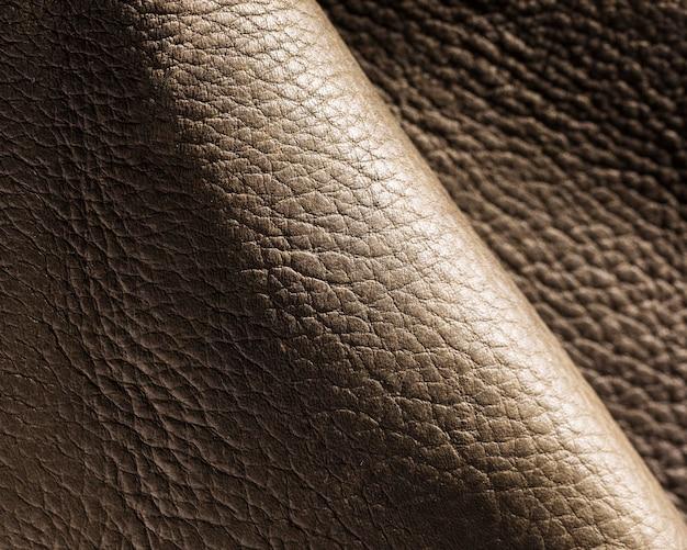 Extreem close-up golvende lederen textuur achtergrond oppervlak Gratis Foto