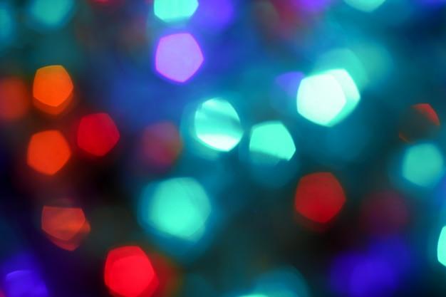Feestelijke bokeh kerstmis achtergrond, sprankelende blauwe achtergrond voor vakantie Premium Foto