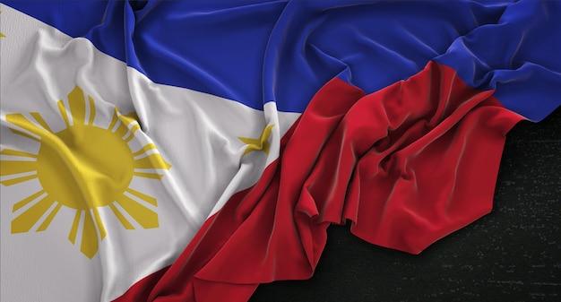 Filippijnen vlag gerimpelde op donkere achtergrond 3d render Gratis Foto