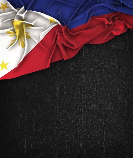 Filippijnen vlag vintage op een grunge black chalkboard met ruimte voor tekst Premium Foto