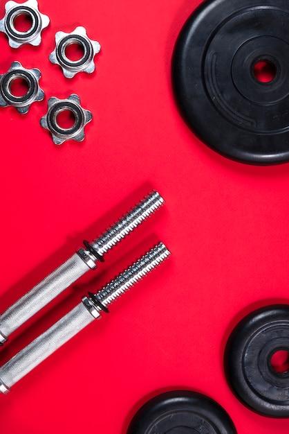 Fitness of bodybuilding. sportuitrusting, barbell, halter, bovenaanzicht Premium Foto