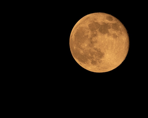 Foto van oranje genomen volle maan Premium Foto