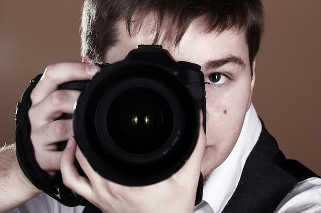 Fotograaf met camera Gratis Foto