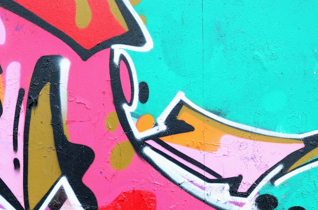 Fragment van een mooi graffitipatroon in roze en groen met een zwarte omtrek. street art achtergrond Premium Foto