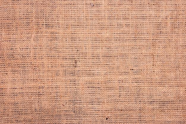 Fragment van ruwe bruine textielachtergrond Premium Foto