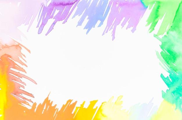 Frame gemaakt met kleurrijke penseelstreken ontwerp met ruimte voor het schrijven van de tekst op een witte achtergrond Gratis Foto