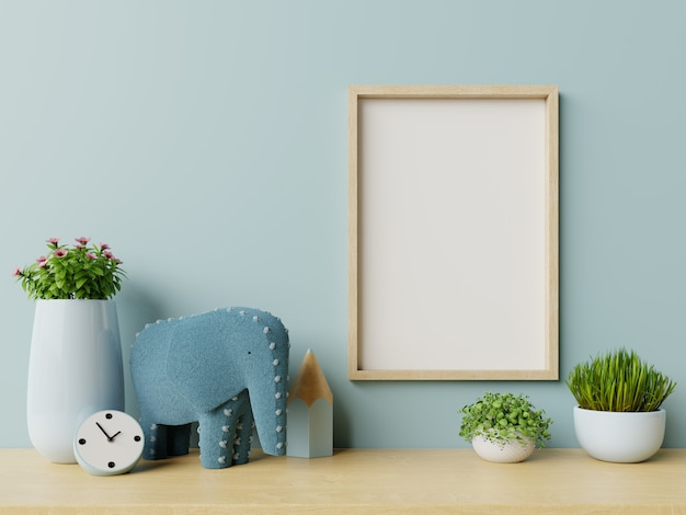 Frame in het interieur van de kinderkamer, frame op lege blauwe muurachtergrond. Premium Foto