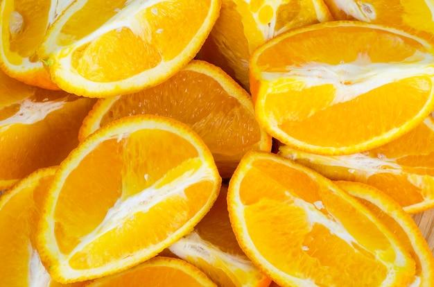 Fruitachtergrond, textuur van oranje plakken. Premium Foto