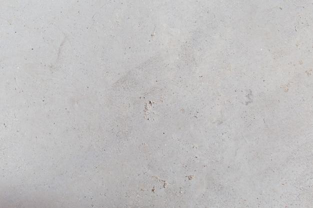 Gebarsten concrete uitstekende muurachtergrond, oude muur - beeld Premium Foto