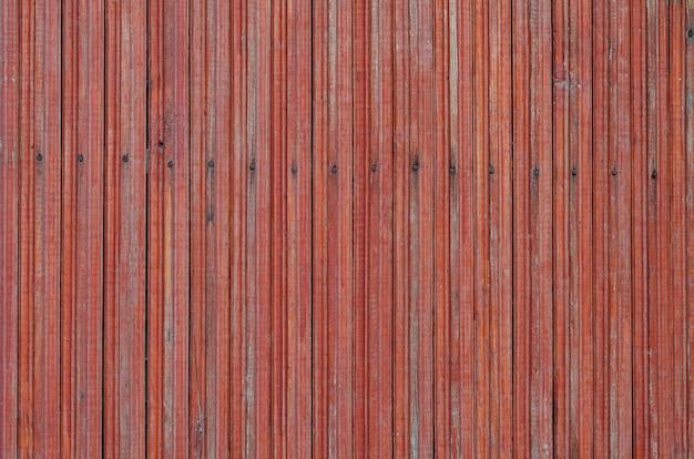 Gebarsten verweerde rood geschilderde houten plank textuur Premium Foto