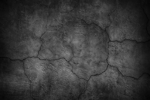 Gebarsten zwarte betonnen muur Premium Foto
