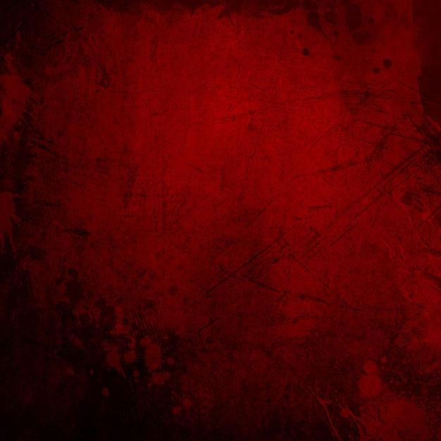 Gedetailleerde rode grunge achtergrond met markeringen en vlekken Gratis Foto
