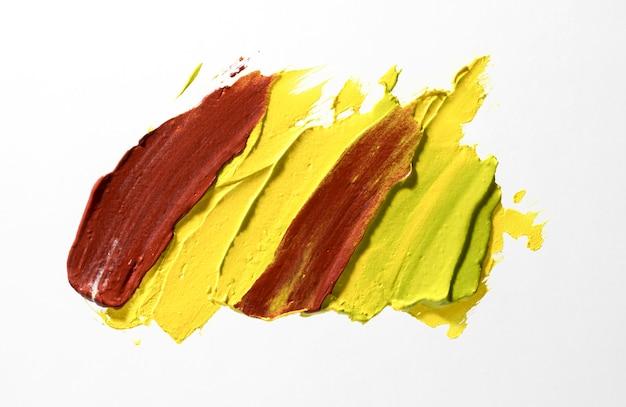 Geel en bruin penseelstreek concept Gratis Foto