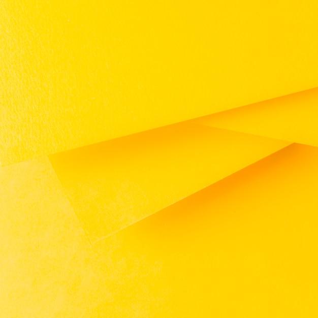 Geel papier achtergrond in minimalistische stijl Gratis Foto