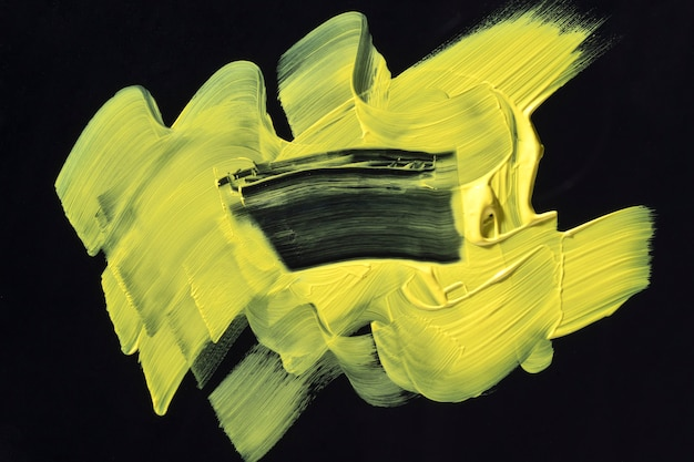 Geel penseelstreek abstract art Gratis Foto