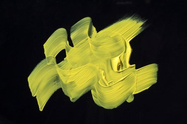 Geel penseelstreek abstract ontwerp Gratis Foto