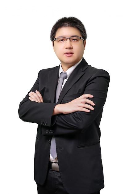 Geïsoleerde jonge aziatische bedrijfsmens in formeel kostuum met stropdas Premium Foto