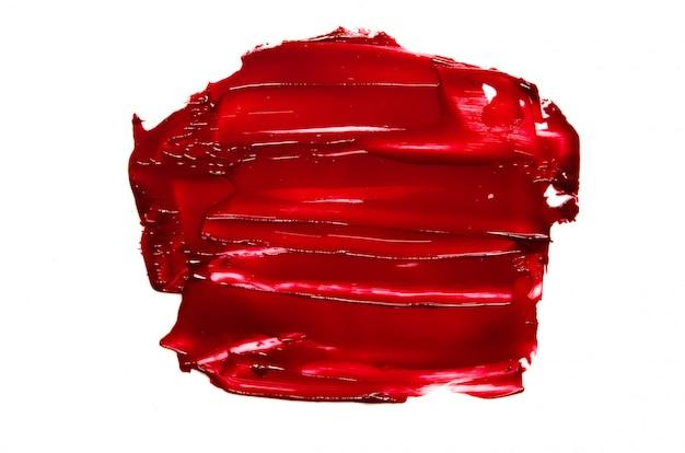 Geïsoleerde vlek en textuur van rode lippenstift of olieverf. Premium Foto