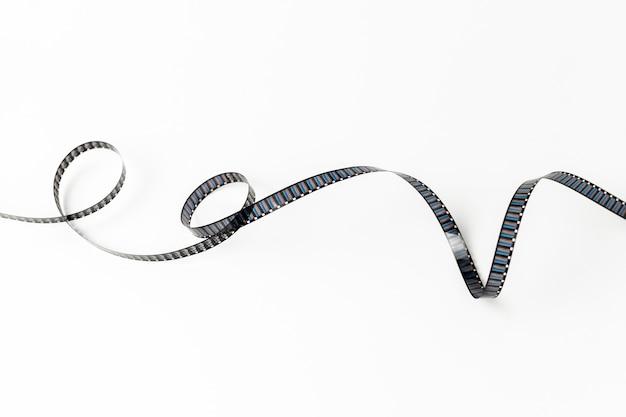 Gekrulde filmstrip geïsoleerd op een witte achtergrond Gratis Foto