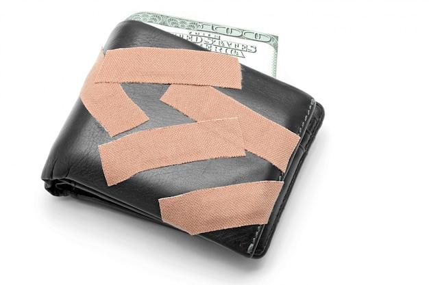 Geld in portemonnee met medisch gips Premium Foto