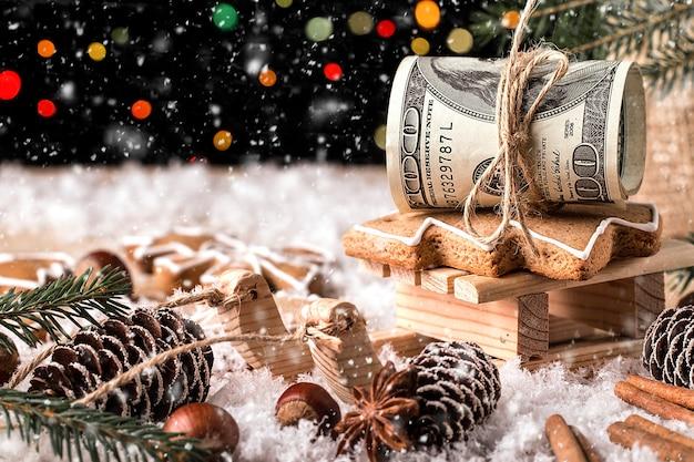 Geld kerstcadeau met houten slee. kerst concept Premium Foto
