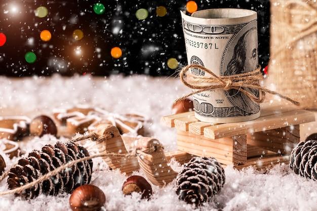 Geld kerstcadeau met houten slee Premium Foto