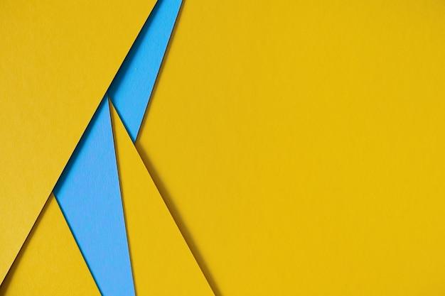 Gele en blauwe geometrische samenstellings kartonachtergrond met copyspace Gratis Foto
