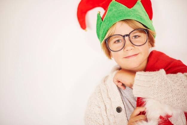 Gelukkig elfje met zak od kerstcadeautjes Gratis Foto