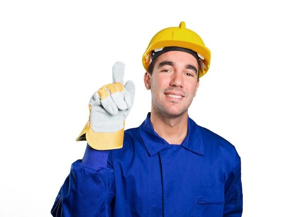 Gelukkige arbeider met nummer één gebaar op witte achtergrond Premium Foto