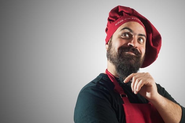 Gelukkige, gebaarde mollige chef-kok Premium Foto