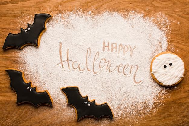 Gelukkige halloween-knuppels op houten lijst Gratis Foto