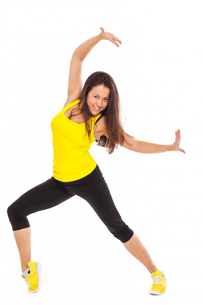 Gelukkige jonge vrouw in fitness slijtage Gratis Foto