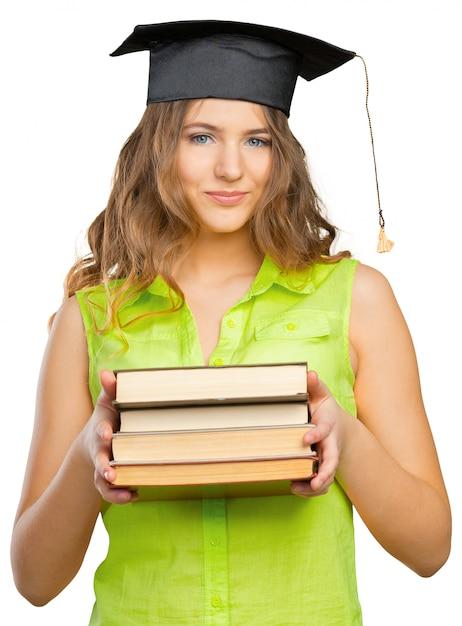 Gelukkige student in afstuderen cap Premium Foto