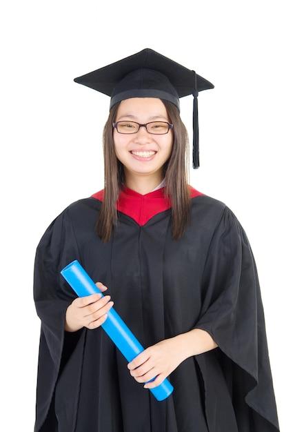 Gelukkige universitaire student in graduatietoga en glb. Premium Foto
