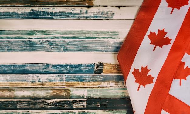 Gelukkige victoria day canadian-vlaggen rustieke achtergrond Premium Foto
