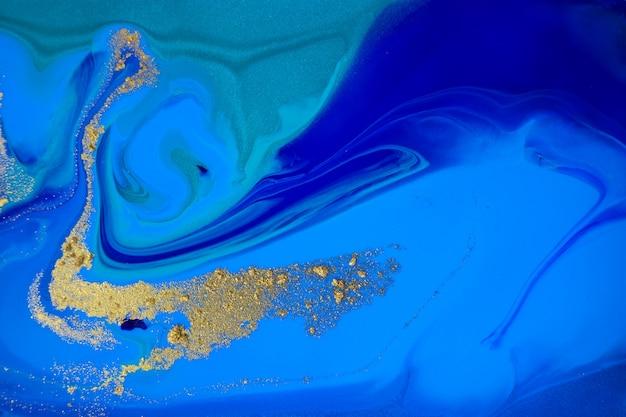 Gemarmerde blauwe en gouden abstracte marmeren achtergrond Premium Foto