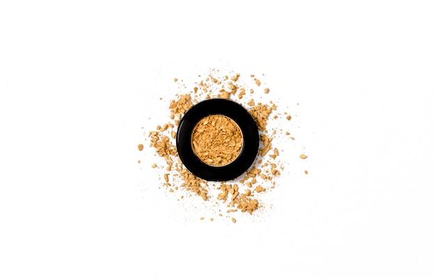 Geplette gouden oogschaduw palet textuur. Premium Foto