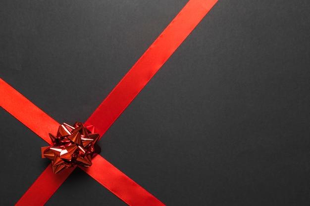 Geschenk boog met rood lint Gratis Foto