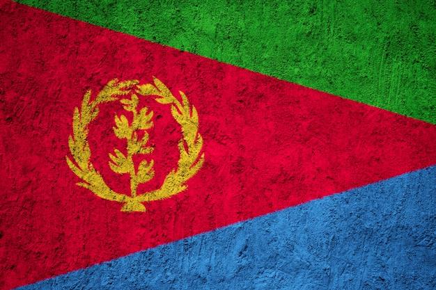 Geschilderde nationale vlag van eritrea op een betonnen muur Premium Foto