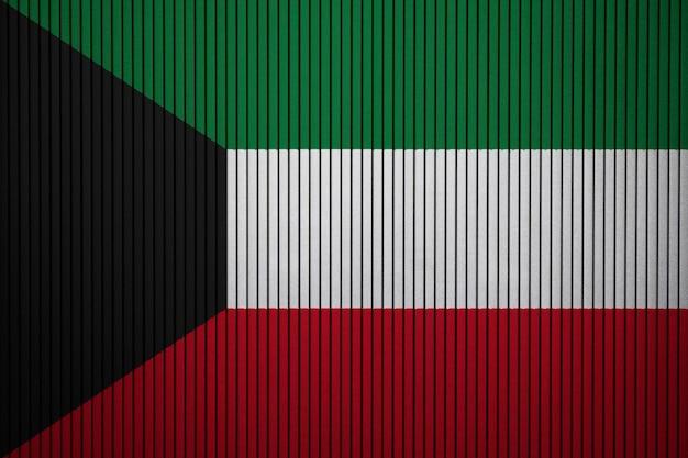 Geschilderde nationale vlag van koeweit op een betonnen muur Premium Foto
