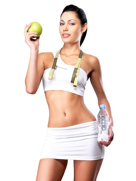 Gezonde levensstijl van vrouw met slank lichaam na dieet. sportieve teef met perfect figuur Gratis Foto
