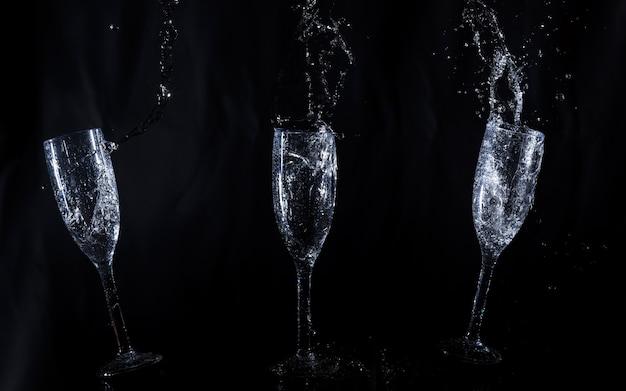Glazen water in beweging Gratis Foto