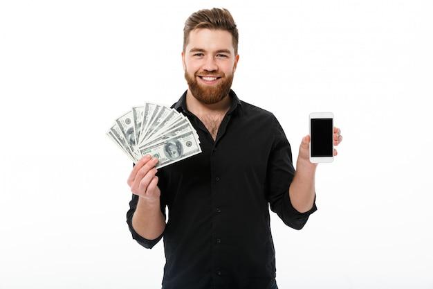 Glimlachende gebaarde bedrijfsmens in het geld van de overhemdsholding Gratis Foto