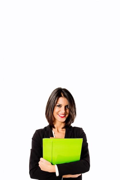 Glimlachende professionele vrouw op witte achtergrond Premium Foto