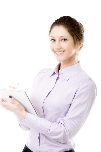 Glimlachende secretaresse schrijven van notities Gratis Foto