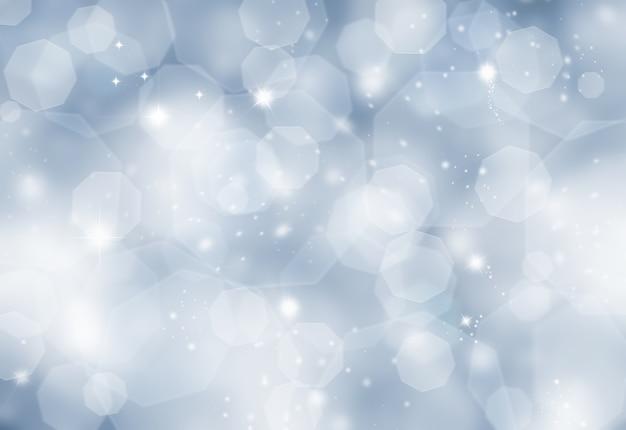 Glittery blauwe kerst achtergrond met bokeh licht effecy Gratis Foto