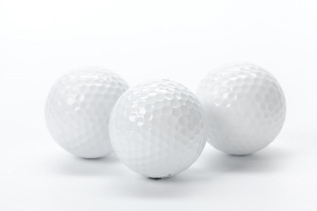 Golfuitrusting op wit wordt geïsoleerd dat Premium Foto