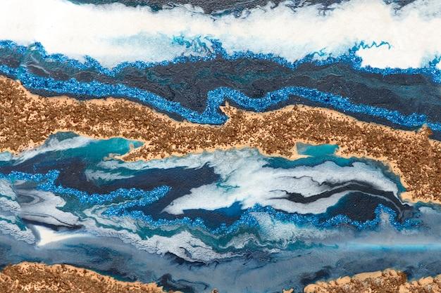 Goud, blauw, wit, glanzend golvende textuur. Premium Foto