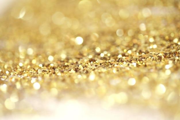 Goud (brons) glitter glans stippen confetti. abstract licht knipperen sparkle defocus achtergrondkleur. Premium Foto