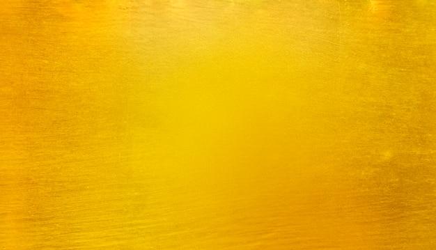 Goud metaal geborsteld achtergrond Premium Foto